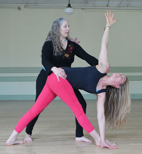 Assisting a Student in Triangle Pose